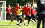 SOUTHAMPTON, ENGLAND - SEPTEMBER 25: LtoR Jannik Vestergaard, Charlie Austin, Oriol Romeu, Mario Lemina during a Southampton FC training session at Staplewood Complex on September 25, 2018 in Southampton, England. (Photo by James Bridle - Southampton FC/Southampton FC via Getty Images)