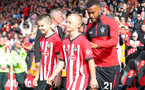 SOUTHAMPTON, ENGLAND - OCTOBER 07: Ryan Bertrand of Southampton leads the teams out with the matchday mascots during the Premier League match between Southampton FC and Chelsea FC at St Mary's Stadium on October 7, 2018 in Southampton, United Kingdom. (Photo by Matt Watson/Southampton FC via Getty Images)