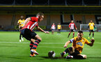 CAMBRIDGE, ENGLAND - OCTOBER 09: Ben Rowthron (left) of Southampton FC during the U21s Checkatade Trophy between Cambridge United and Southampton FC pictured at Abbey Stadium on October 9, 2018 in Cambridge, England. (Photo by James Bridle - Southampton FC/Southampton FC via Getty Images)