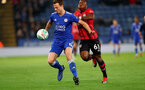LEICESTER, ENGLAND - NOVEMBER 27: Michael Obafemi(R) of Southampton and Jonny Evans of Leicester during the Carabao Cup Fourth Round match between Leicester City and Southampton at The King Power Stadium on November 27th, 2018 in Leicester, England. (Photo by Matt Watson/Southampton FC via Getty Images)
