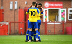 NOTTINGHAM, ENGLAND - NOVEMBER 28: Harry Hamblin scores for Southampton FC  and celebrates with Marcus Barnes and Will Smallbone during the Cup match between Notts County and Southampton at IIklestone Town FC on November 28, 2018 in Nottingham, England. (Photo by James Bridle - Southampton FC/Southampton FC via Getty Images)