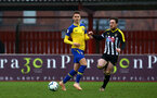 NOTTINGHAM, ENGLAND - NOVEMBER 28: Will Smallbone (left) during the Cup match between Notts County and Southampton at IIklestone Town FC on November 28, 2018 in Nottingham, England. (Photo by James Bridle - Southampton FC/Southampton FC via Getty Images)