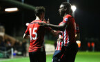 SOUTHAMPTON, ENGLAND - DECEMBER 11: Jonathan Afolabi congratulates Will Ferry after he scores from s corner during the U23s Cup match between Southampton FC and West Ham United pictured at Staplewood Training Ground on December 11, 2018 in Southampton England. (Photo by James Bridle - Southampton FC/Southampton FC via Getty Images)