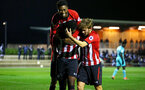 SOUTHAMPTON, ENGLAND - DECEMBER 14: Jonathan Afolabi scores (Left) and celebrates with Nathan Tella and Jake Vokins (right) during the U23s Cup match between Southampton FC and Newcastle United pictured at Staplewood Training Ground on December 14, 2018 in Southampton England. (Photo by James Bridle - Southampton FC/Southampton FC via Getty Images)