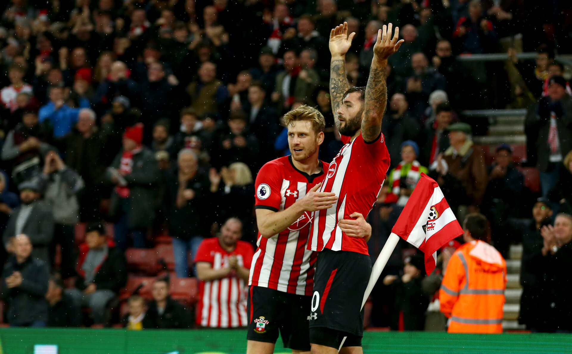 SOUTHAMPTON, ENGLAND - DECEMBER 16: Charlie Austin(R) of Southampton celebrates scoring with team mate Stuart Armstrong(L) during the Premier League match between Southampton FC and Arsenal FC at St Mary's Stadium on December 15, 2018 in Southampton, United Kingdom. (Photo by Matt Watson/Southampton FC via Getty Images)
