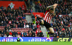 SOUTHAMPTON, ENGLAND - DECEMBER 16: Danny Ings jumps to block the ball from a goal kick during the Premier League match between Southampton FC and Arsenal FC at St Mary's Stadium on December 16, 2018 in Southampton, United Kingdom. (Photo by James Bridle - Southampton FC/Southampton FC via Getty Images)