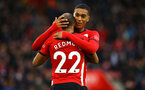 SOUTHAMPTON, ENGLAND - DECEMBER 16:  Yan Valery hugs Nathan Redmond during the Premier League match between Southampton FC and Arsenal FC at St Mary's Stadium on December 16, 2018 in Southampton, United Kingdom. (Photo by James Bridle - Southampton FC/Southampton FC via Getty Images)