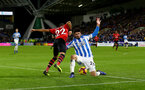 HUDDERSFIELD, ENGLAND - DECEMBER 22:  Nathan Redmond(L) of Southampton beats Christopher Schindler of Huddersfield Town during the Premier League match between Huddersfield Town and Southampton FC at John Smith's Stadium on December 22, 2018 in Huddersfield, United Kingdom. (Photo by Matt Watson/Southampton FC via Getty Images)