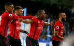 HUDDERSFIELD, ENGLAND - DECEMBER 22:  Michael Obafemi(centre) of Southampton celebrates during the Premier League match between Huddersfield Town and Southampton FC at John Smith's Stadium on December 22, 2018 in Huddersfield, United Kingdom. (Photo by Matt Watson/Southampton FC via Getty Images)