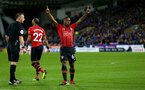 HUDDERSFIELD, ENGLAND - DECEMBER 22:  Michael Obafemi of Southampton celebrates after scoring his teams third goal during the Premier League match between Huddersfield Town and Southampton FC at John Smith's Stadium on December 22, 2018 in Huddersfield, United Kingdom. (Photo by Matt Watson/Southampton FC via Getty Images)