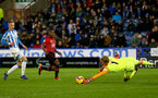 HUDDERSFIELD, ENGLAND - DECEMBER 22:  Michael Obafemi of Southampton is denied by Jonas Lossl of Huddersfield Town during the Premier League match between Huddersfield Town and Southampton FC at John Smith's Stadium on December 22, 2018 in Huddersfield, United Kingdom. (Photo by Matt Watson/Southampton FC via Getty Images)