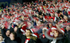 HUDDERSFIELD, ENGLAND - DECEMBER 22: fans of Southampton wave Santa hats during the Premier League match between Huddersfield Town and Southampton FC at John Smith's Stadium on December 22, 2018 in Huddersfield, United Kingdom. (Photo by Matt Watson/Southampton FC via Getty Images)