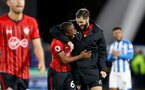 HUDDERSFIELD, ENGLAND - DECEMBER 22: Michael Obafemi(L) and Charlie Austin of Southampton during the Premier League match between Huddersfield Town and Southampton FC at John Smith's Stadium on December 22, 2018 in Huddersfield, United Kingdom. (Photo by Matt Watson/Southampton FC via Getty Images)