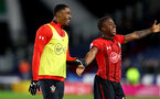 HUDDERSFIELD, ENGLAND - DECEMBER 22:  Kayne Ramsay(L) of Southampton and Michael Obafemi(R) during the Premier League match between Huddersfield Town and Southampton FC at John Smith's Stadium on December 22, 2018 in Huddersfield, United Kingdom. (Photo by Matt Watson/Southampton FC via Getty Images)