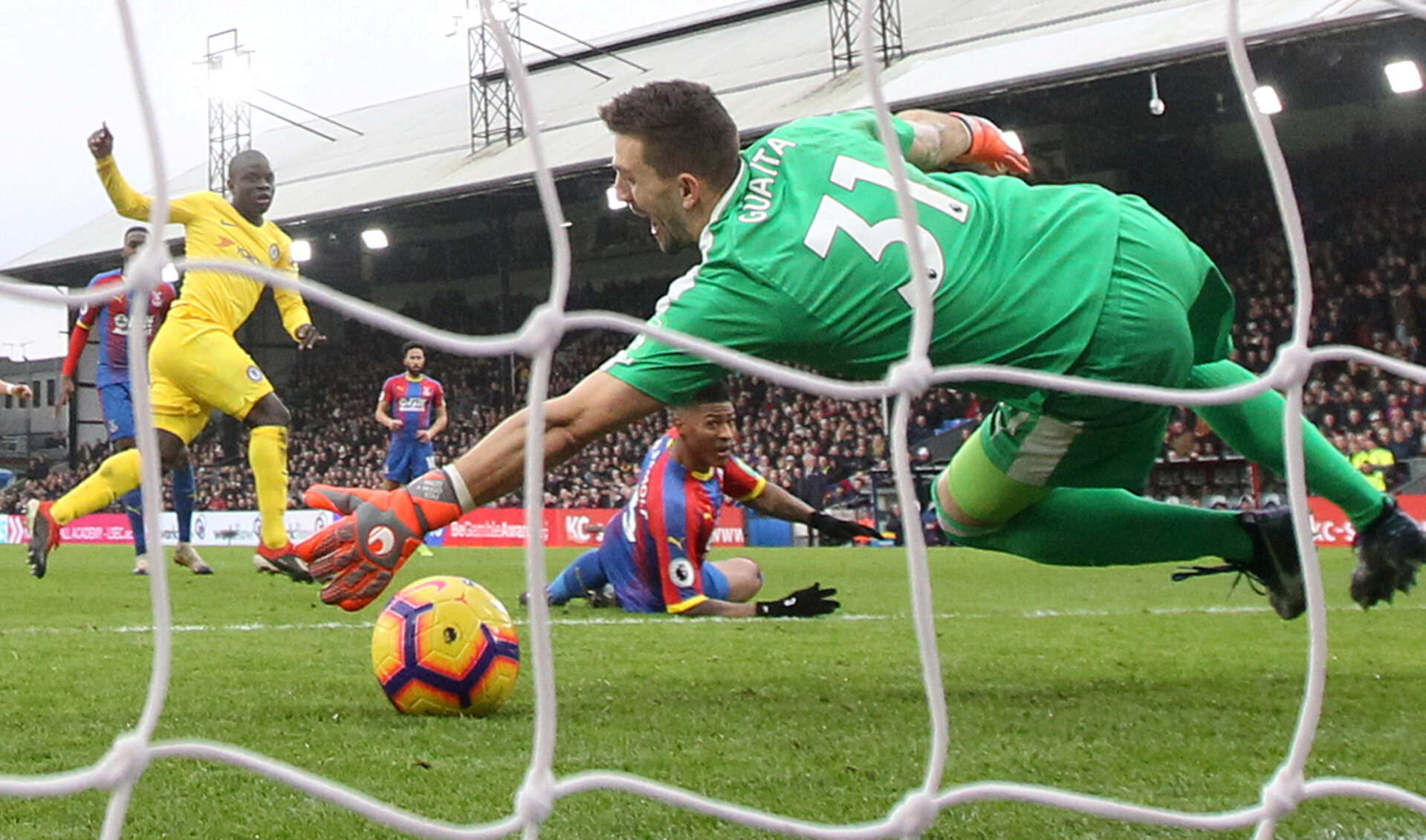 """Soccer Football - Premier League - Crystal Palace v Chelsea - Selhurst Park, London, Britain - December 30, 2018  Chelsea's N'Golo Kante scores their first goal past Crystal Palace's Vicente Guaita    REUTERS/David Klein  EDITORIAL USE ONLY. No use with unauthorized audio, video, data, fixture lists, club/league logos or """"live"""" services. Online in-match use limited to 75 images, no video emulation. No use in betting, games or single club/league/player publications.  Please contact your account representative for further details.     TPX IMAGES OF THE DAY"""