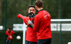SOUTHAMPTON, ENGLAND - JANUARY 15: LtoR Danny Ings pulls on his jumper while talking to Jack Stephens during a Southampton FC  training session at Staplewood Complex on January 15, 2019 in Southampton, England. (Photo by James Bridle - Southampton FC/Southampton FC via Getty Images)