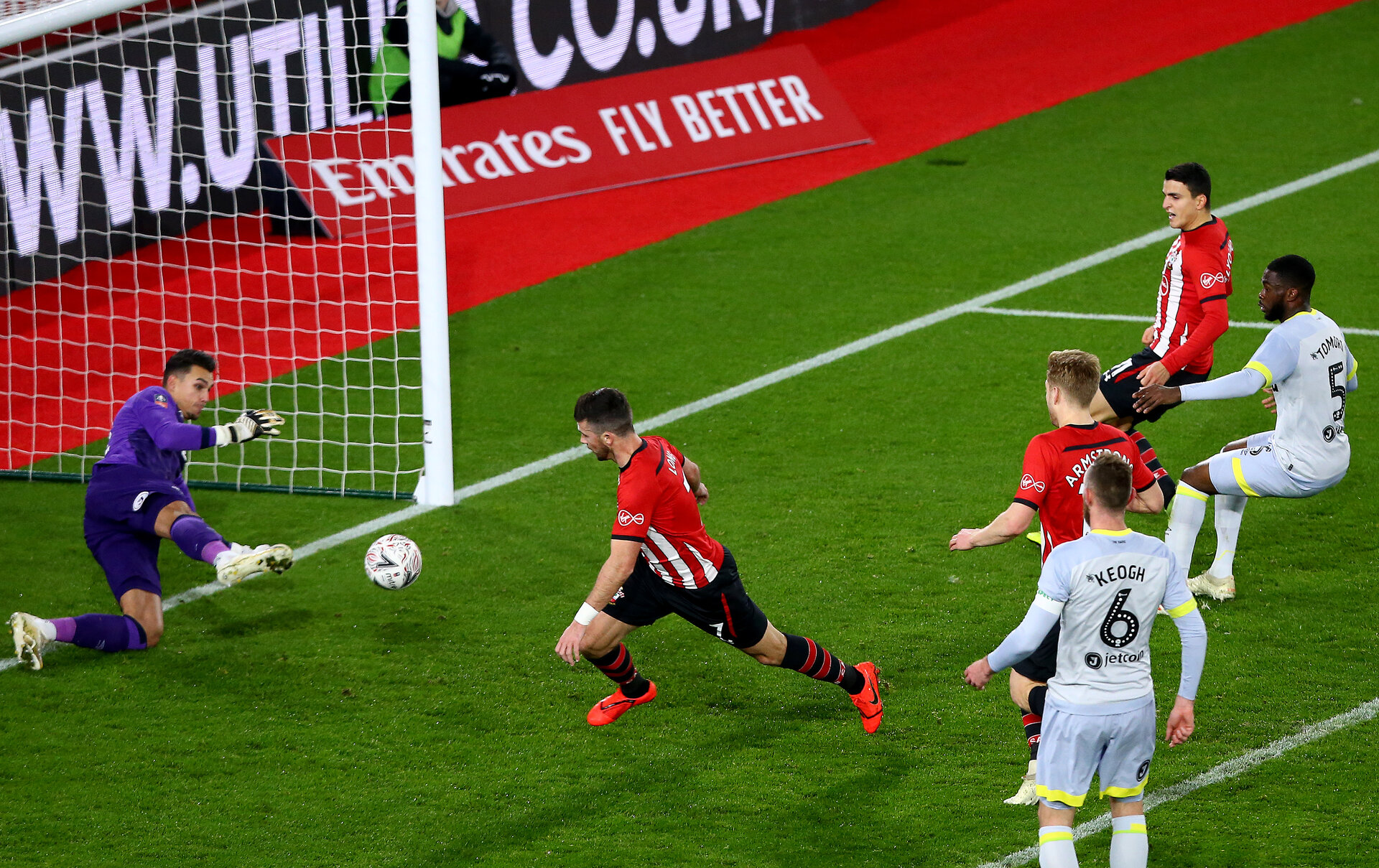 SOUTHAMPTON, ENGLAND - JANUARY 16: Shane Long of Southampton is denied by Derby goalkeeper Kelle Roos during the FA Cup Third Round Replay match between Southampton FC and Derby County at St Mary's Stadium on January 16, 2019 in Southampton, United Kingdom. (Photo by Matt Watson/Southampton FC via Getty Images)