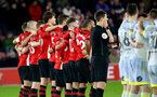 SOUTHAMPTON, ENGLAND - JANUARY 16: Players of Southampton wait as penalty's are taken during the FA Cup Third Round Replay match between Southampton FC and Derby County at St Mary's Stadium on January 16, 2019 in Southampton, United Kingdom. (Photo by Matt Watson/Southampton FC via Getty Images)