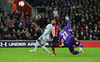 SOUTHAMPTON, ENGLAND - JANUARY 16:  Nathan Redmond (middle) of Southampton FC scores by chipping the ball over Derby County's Kelle Roos (right) during the FA Cup Third Round Replay match between Southampton FC and Derby County at St Mary's Stadium on January 16, 2019 in Southampton, United Kingdom. (Photo by James Bridle - Southampton FC/Southampton FC via Getty Images)