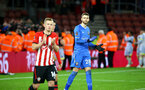 SOUTHAMPTON, ENGLAND - JANUARY 16: Angus Gunn (right) during the FA Cup Third Round Replay match between Southampton FC and Derby County at St Mary's Stadium on January 16, 2019 in Southampton, United Kingdom. (Photo by James Bridle - Southampton FC/Southampton FC via Getty Images)
