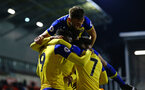 LEIGH, GREATER MANCHESTER - FEBRUARY 01:  Harry Hamblin jumps on the backs of his team mates as Jonathan Afolabi (left) scores for Southampton FC during the PL2 match between Manchester United and Southampton FC pictured at Leigh Sports Village on February 01, 2019 in Leigh, Greater Manchester. (Photo by James Bridle - Southampton FC/Southampton FC via Getty Images)