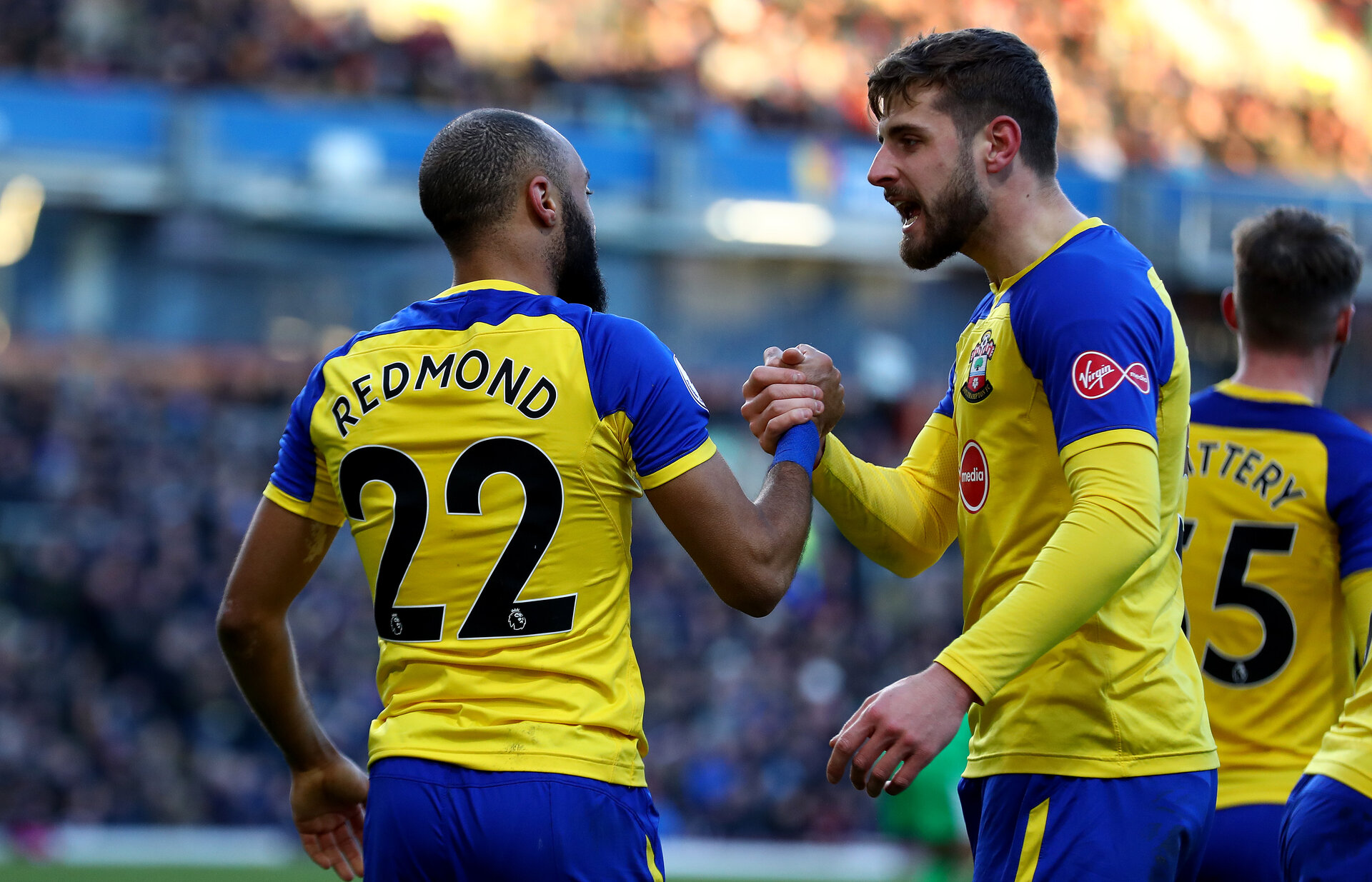 BURNLEY, ENGLAND - FEBRUARY 02: Nathan Redmond of Southampton celebrates with Jack Stephens during the Premier League match between Burnley FC and Southampton FC at Turf Moor on February 02, 2019 in Burnley, United Kingdom. (Photo by Matt Watson/Southampton FC via Getty Images)