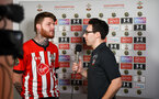 SOUTHAMPTON, ENGLAND - FEBRUARY 14: Tom Deacon (right) interviews 'EastCowsCrews' after being knocked out during the ePremier League tournament held at St Mary's Stadium on February 14, 2019 in Southampton, England. (Photo by James Bridle - Southampton FC/Southampton FC via Getty Images)