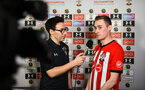 SOUTHAMPTON, ENGLAND - FEBRUARY 14: PS4 Tom Deacon (left) Interviews one of the players (right) during the ePremier League tournament held at St Mary's Stadium on February 14, 2019 in Southampton, England. (Photo by James Bridle - Southampton FC/Southampton FC via Getty Images)
