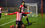 SOUTHAMPTON, ENGLAND - FEBRUARY 15: Jonathan Afolabi for Southampton FC (middle) scores and celebrates with Oludare Olufunwa during the U23s PL2 match between Southampton FC and Fulham FC pictured at Staplewood Complex on February 15, 2019 in Southampton, England. (Photo by James Bridle - Southampton FC/Southampton FC via Getty Images)