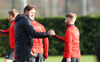 Ralph Hasenhuttl greets Josh Sims(R) during a Southampton FC training session at the Staplewood Campus, Southampton, 19th February 2019