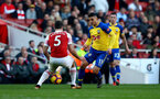 LONDON, ENGLAND - FEBRUARY 24: Mohamed Elyounoussi of Southampton nutmegs Sokratis Papastathopoulos of Arsenal during the Premier League match between Arsenal FC and Southampton FC at Emirates Stadium on February 24, 2019 in London, United Kingdom. (Photo by Matt Watson/Southampton FC via Getty Images)