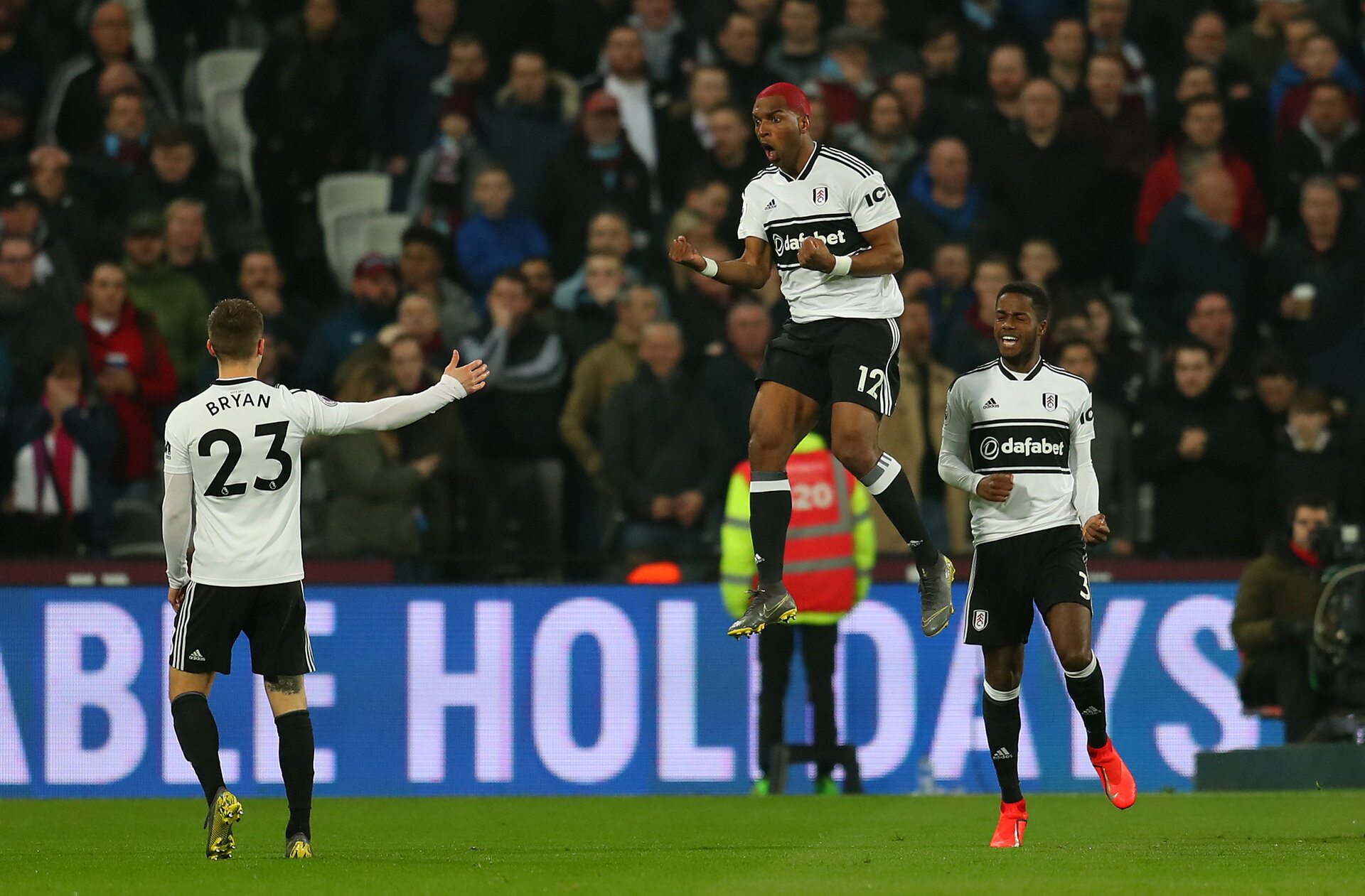 LONDON, ENGLAND - FEBRUARY 22:  Ryan Babel of Fulham (c) celebrates scoring his side's first goal during the Premier League match between West Ham United and Fulham FC at the London Stadium on February 22, 2019 in London, United Kingdom. (Photo by Catherine Ivill/Getty Images)