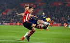 SOUTHAMPTON, ENGLAND - FEBRUARY 27:  James Ward-Prowse of Southampton FC (left) challenges Fulham's Tim Ream (right) during the Premier League match between Southampton FC and Fulham FC at St Mary's Stadium on February 27, 2019 in Southampton, United Kingdom. (Photo by James Bridle - Southampton FC/Southampton FC via Getty Images)