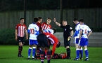 SOUTHAMPTON, ENGLAND - MARCH 01: Nathan Tella goes down (middle) during the PL2 match between Southampton FC and Reading FC pictured at Staplewood Complex on March 01, 2019 in Southampton, England. (Photo by James Bridle - Southampton FC/Southampton FC via Getty Images)
