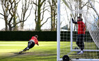 SOUTHAMPTON, ENGLAND - MARCH 07:  Angus Gunn makes a save (left) during a Southampton FC training session pictured at Staplewood Complex on March 07, 2019 in Southampton, England. (Photo by James Bridle - Southampton FC/Southampton FC via Getty Images)