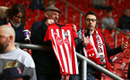 SOUTHAMPTON, ENGLAND - MARCH 09: Tom Deacon (right) with an older fan (left) during the Premier League match between Southampton FC and Tottenham Hotspur at St Mary's Stadium on March 09, 2019 in Southampton, United Kingdom. (Photo by James Bridle - Southampton FC/Southampton FC via Getty Images)