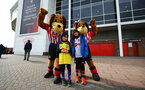 SOUTHAMPTON, ENGLAND - MARCH 09: Sammy Saint of Southampton with Southampton FC fans ahead of the Premier League match between Southampton FC and Tottenham Hotspur at St Mary's Stadium on March 09, 2019 in Southampton, United Kingdom. (Photo by James Bridle - Southampton FC/Southampton FC via Getty Images)
