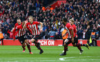 SOUTHAMPTON, ENGLAND - MARCH 09:  LtoR Pierre-Emile Hojbjerg, Yan Valery, James Ward-Prowse, Ryan Bertrand, Josh Sims celebrate as James Ward-Prowse scores for Southampton FC (middle) during the Premier League match between Southampton FC and Tottenham Hotspur at St Mary's Stadium on March 09, 2019 in Southampton, United Kingdom. (Photo by James Bridle - Southampton FC/Southampton FC via Getty Images)