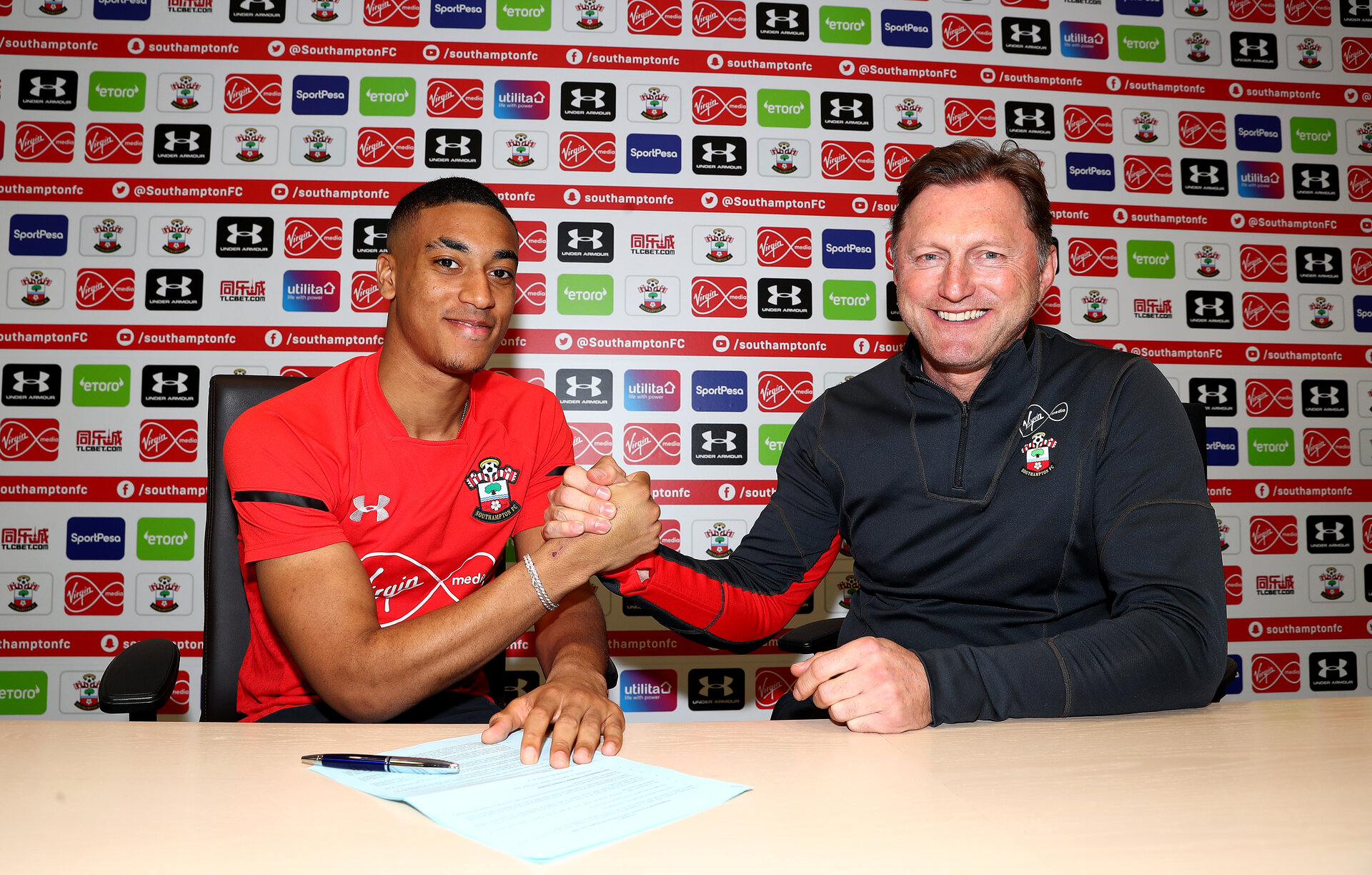 SOUTHAMPTON, ENGLAND - MARCH 14: Yan Valery signs a new contract to stay with the club until 2023, pictured with manager Ralph Hasenhuttl(R) at the Staplewood Campus on March 14, 2019 in Southampton, England. (Photo by Matt Watson/Southampton FC via Getty Images)
