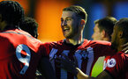 SOUTHAMPTON, ENGLAND - APRIL 05:  Callum Slattery celebrates with goal scorer Tyreke Johnson (right) during the U23's PL2 match between Southampton FC and Norwich City pictured at Staplewood Complex on April 05, 2019 in Southampton, England. (Photo by James Bridle - Southampton FC/Southampton FC via Getty Images)