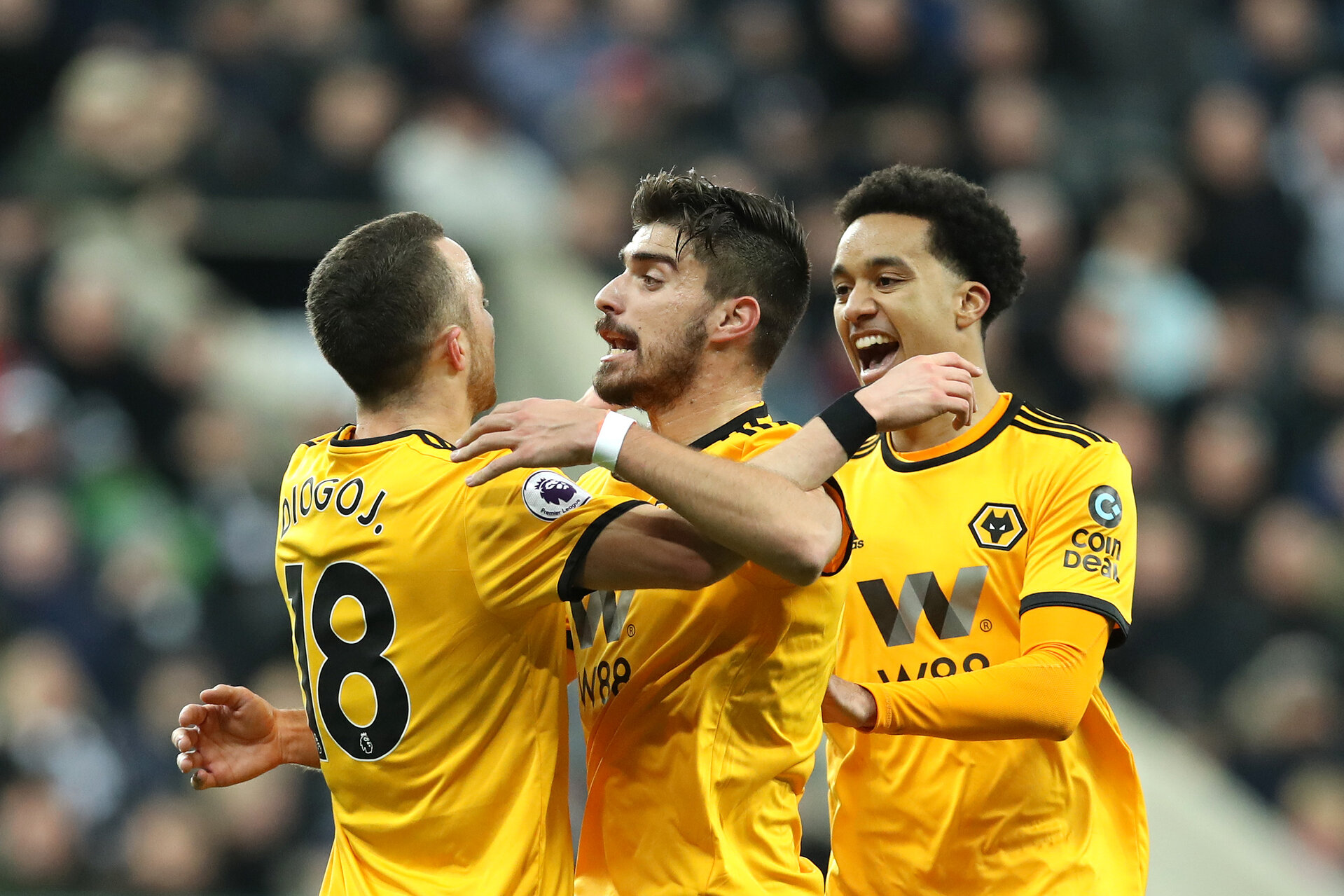 NEWCASTLE UPON TYNE, ENGLAND - DECEMBER 09:  Diogo Jota of Wolverhampton Wanderers (L) celebrates after scoring his team's first goal Conor with Ruben Neves during the Premier League match between Newcastle United and Wolverhampton Wanderers at St. James Park on December 9, 2018 in Newcastle upon Tyne, United Kingdom.  (Photo by Ian MacNicol/Getty Images)