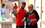 SOUTHAMPTON, ENGLAND - APRIL 17: Nathan Redmond (left) of Southampton FC visits Southampton General Hospital pictured with patients and staff on April 17, 2019 in Southampton, England. (Photo by James Bridle - Southampton FC/Southampton FC via Getty Images)