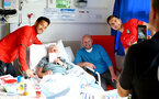 SOUTHAMPTON, ENGLAND - APRIL 17: LtoR Maya Yoshida, Jan Bednarek of Southampton FC visits Southampton General Hospital pictured with patients and staff on April 17, 2019 in Southampton, England. (Photo by James Bridle - Southampton FC/Southampton FC via Getty Images)