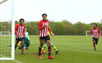 NORWICH, ENGLAND - APRIL 27: Caleb Watts (left) assists Christian Norton (middle) in scoring during a U18 Premier League match between Norwich City FC and Southampton FC pictured at Colney Training Ground on April 27, 2019 in Norwich, England. (Photo by James Bridle - Southampton FC/Southampton FC via Getty Images)