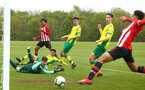 NORWICH, ENGLAND - APRIL 27: Caleb Watts (middle) assists Christian Norton (right)  in scoring during a U18 Premier League match between Norwich City FC and Southampton FC pictured at Colney Training Ground on April 27, 2019 in Norwich, England. (Photo by James Bridle - Southampton FC/Southampton FC via Getty Images)