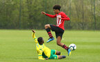 NORWICH, ENGLAND - APRIL 27: Caleb Watts jumps over a Norwich player during a U18 Premier League match between Norwich City FC and Southampton FC pictured at Colney Training Ground on April 27, 2019 in Norwich, England. (Photo by James Bridle - Southampton FC/Southampton FC via Getty Images)
