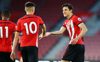 SOUTHAMPTON, ENGLAND - APRIL 29: Will Smallbone takes a penalty for Southampton FC and scores celebrating with Alfie Jones (right)  during the Premier League 2 match between Southampton FC and Sunderland pictured at St Mary's Stadium on April 29, 2019 in Southampton, England. (Photo by James Bridle - Southampton FC/Southampton FC via Getty Images)