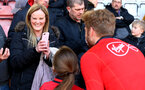 SOUTHAMPTON, ENGLAND - MAY 08: Stuart Armstrong (right) has a photo with a fan during a Southampton FC open training session at St Mary's Stadium on May 08, 2019 in Southampton, England. (Photo by James Bridle - Southampton FC/Southampton FC via Getty Images)
