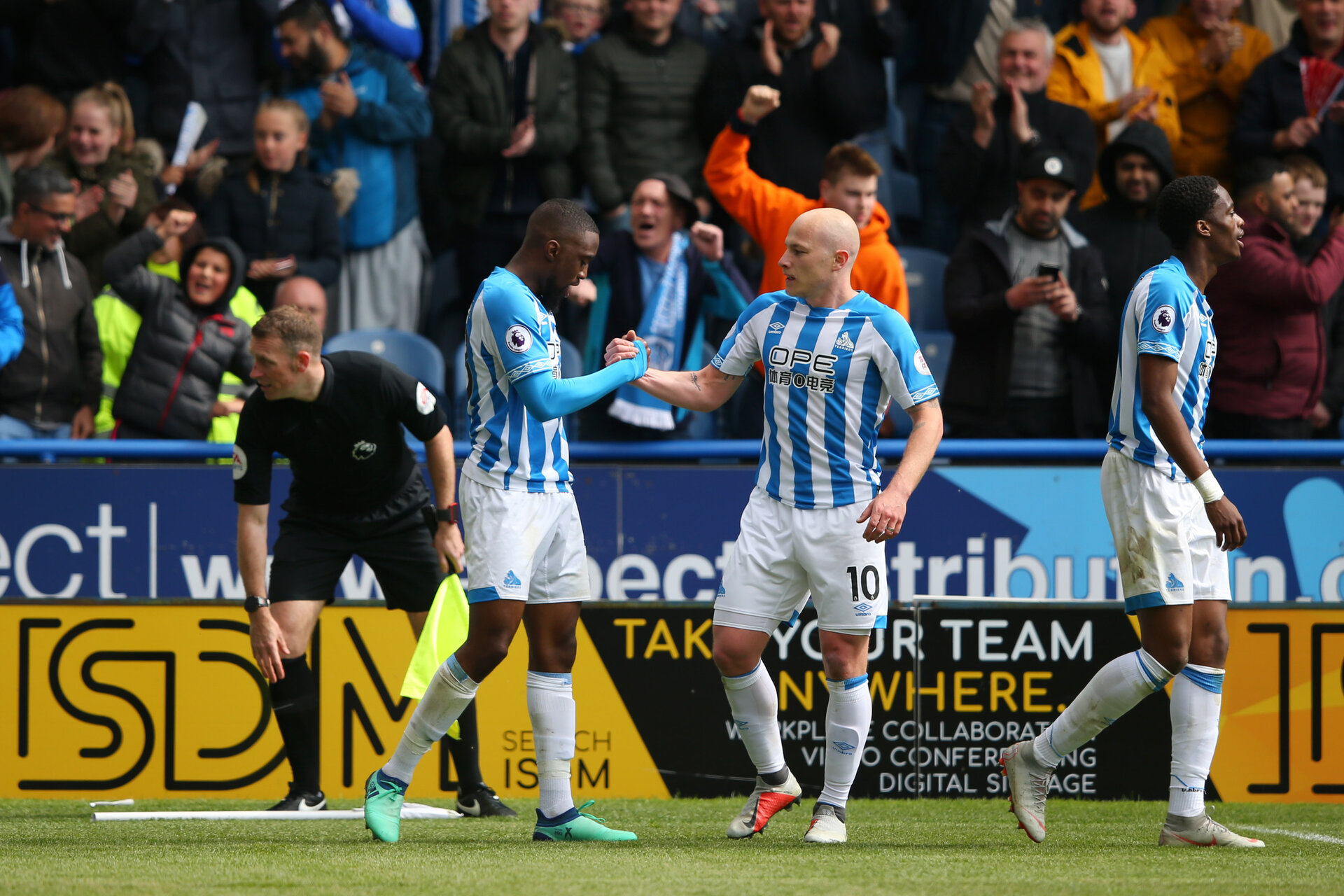 HUDDERSFIELD, ENGLAND - MAY 05:  Isaac Mbenza of Huddersfield Town celebrates as he scores his team's first goal with Aaron Mooy during the Premier League match between Huddersfield Town and Manchester United at John Smith's Stadium on May 05, 2019 in Huddersfield, United Kingdom. (Photo by Alex Livesey/Getty Images)