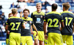 PRESTON, ENGLAND - JULY 20: Christoph Klarer (middle)  celebrates with the team after Jake Vokins  scores in the second half of the pre-season friendly game between Preston North End and Southampton FC pictured at Deepdale on July 20, 2019 in Preston, England. (Photo by James Bridle - Southampton FC/Southampton FC via Getty Images)